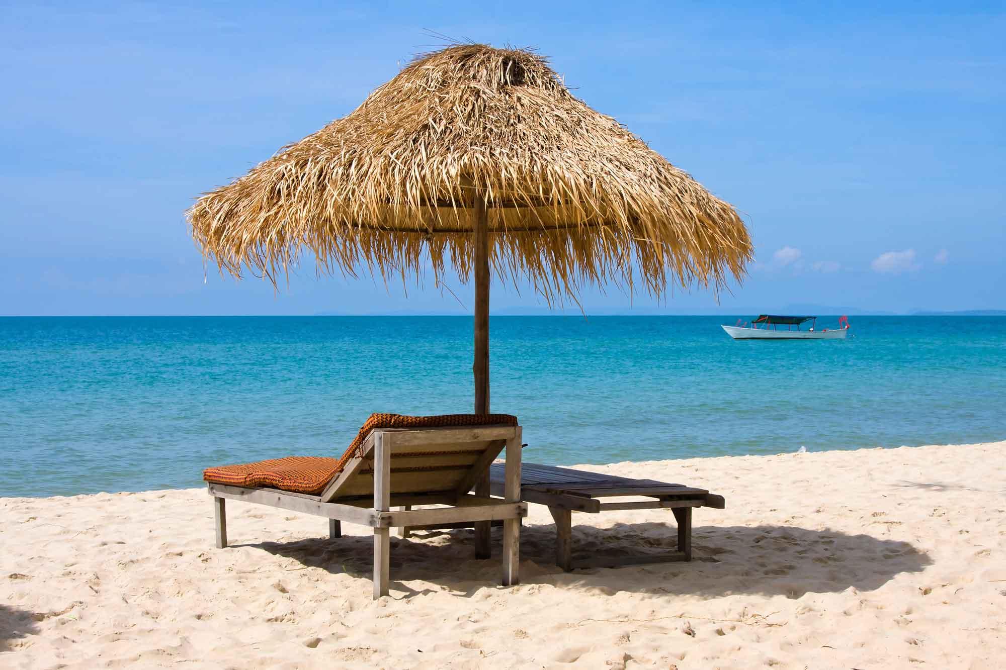 Overseas Landlords - Umbrella on beach